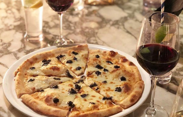 Any pizza at Portico (Spiga terrace)